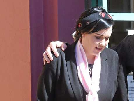 THE wife of alleged Murwillumbah murderer Michael Martin Jnr faces court over the death of Michael Martin Snr.