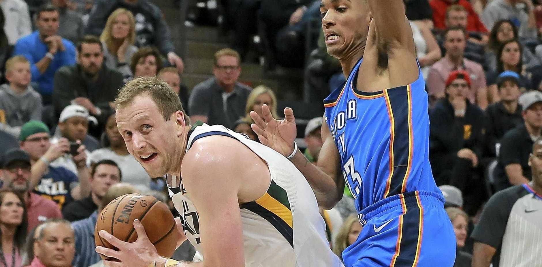 Utah Jazz forward Joe Ingles (2) tries to get past Oklahoma City Thunder guard Terrance Ferguson (23)  in Salt Lake City.