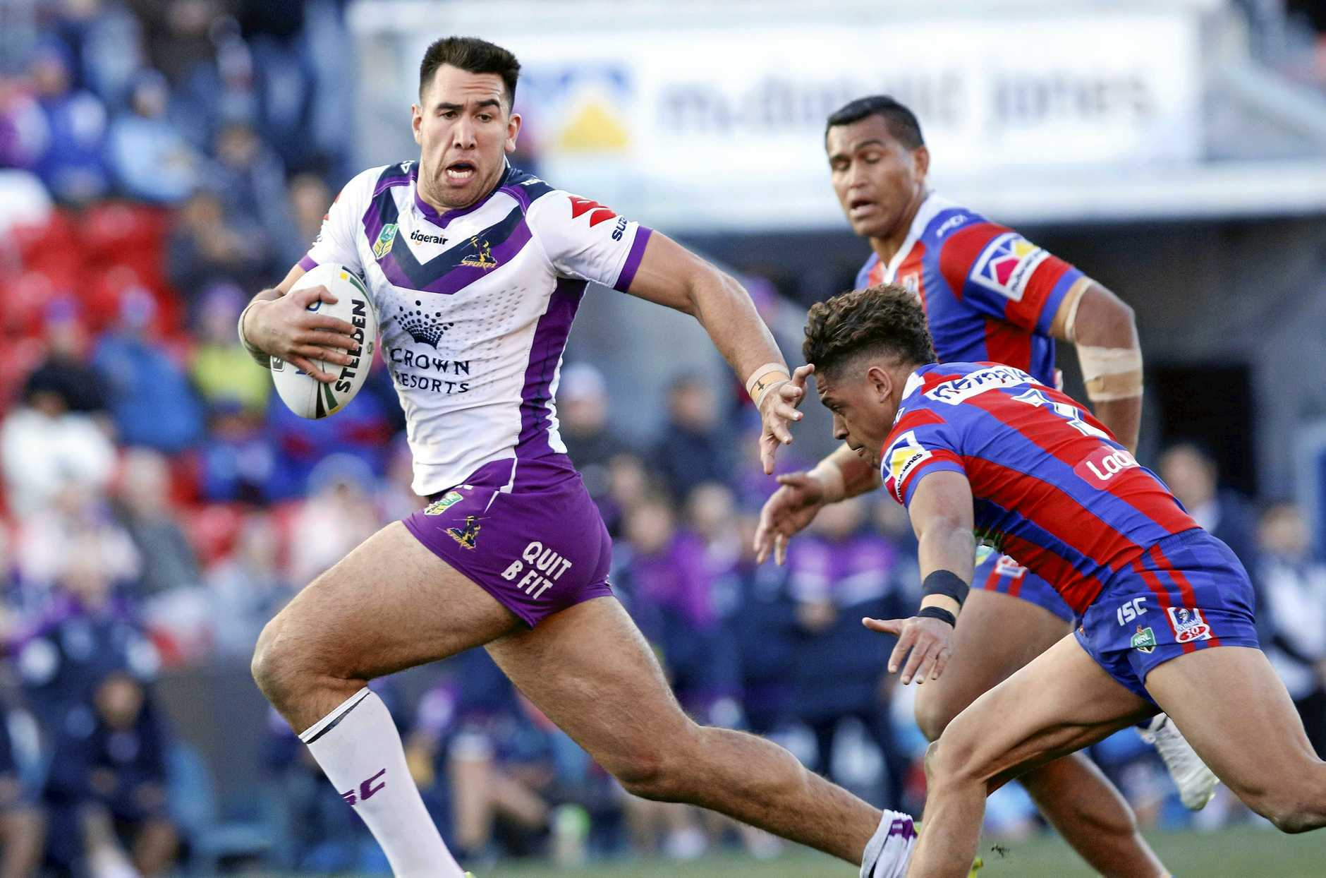 Nelson Asofa-Solomona of the Storm fends off Dane Gagai of the Knights during the Round 24 NRL match between the Newcastle Knights and the Melbourne Storm at McDonald Jones Stadium in Newcastle, Saturday, August 19, 2017. (AAP Image/Darren Pateman) NO ARCHIVING, EDITORIAL USE ONLY