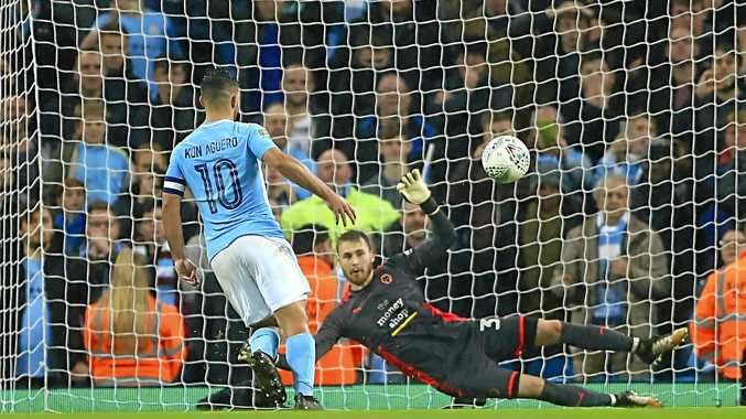 Manchester City's Sergio Aguero scores the winning penalty during the English League Cup win over Wolves.