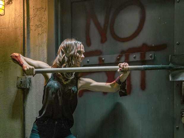 Laura Vandervoort in a scene from Jigsaw.