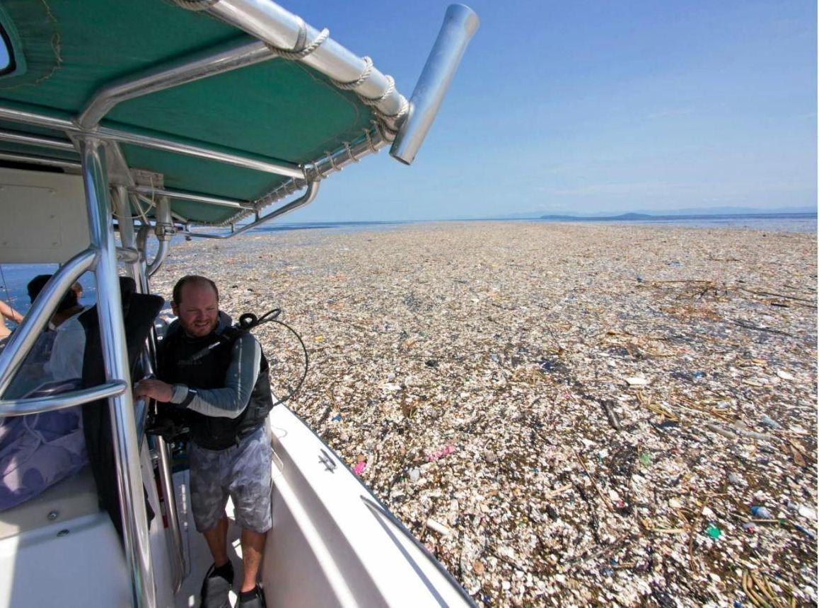 Nicholas Christian Bach surveys a sea of plastic and Styrofoam.