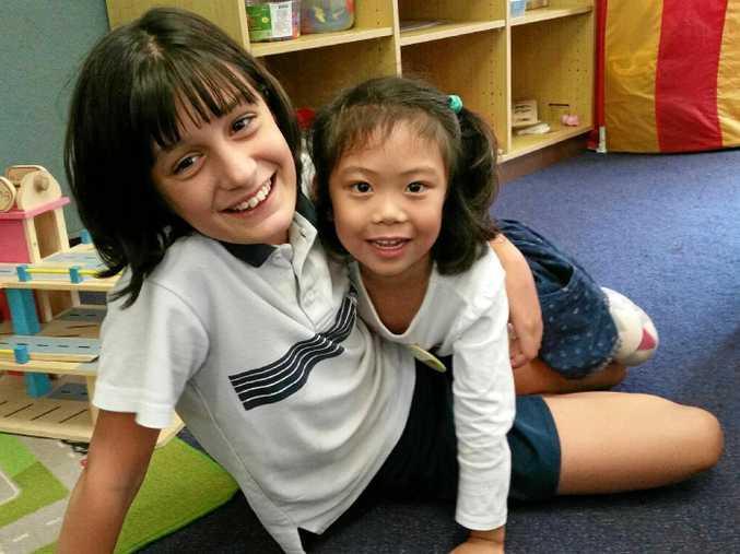 FUN TIME: Centaur Prmiary School student Halaina Stewart helps Suzelle Neri prepare for school in 2018.