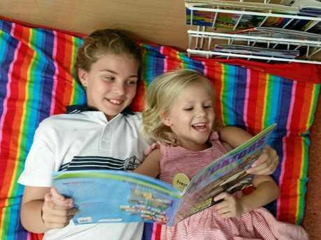 QUALITY TIME: Maddison Morton and Freya Mitchell enjoy some reading at Centaur Primary School.