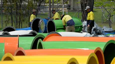 Workers start the task of assembling the 42nd Battalion Memorial Pool waterslide in North Rockhampton.