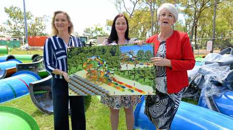L-R Cr. Cherie Rutherford, Member for Keppel Brittany Lauga and Mayor Margaret Strelow with an artists impression of the waterslide as it will look while surrounded by the composite parts of the actual slide.