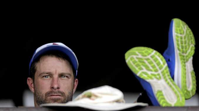Australia cricketer Matthew Wade rests during a practice session in Nagpur, India.