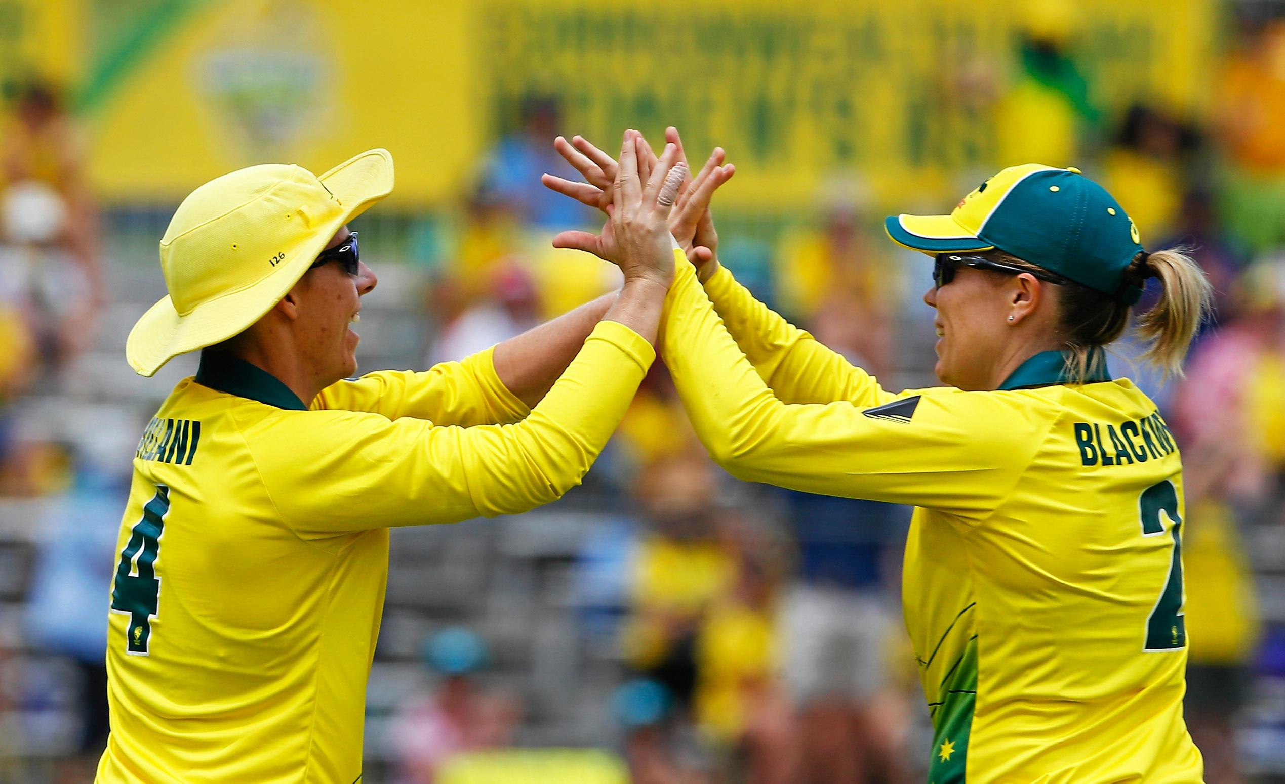 Experienced Southern Stars pair Elyse Villani and Alex Blackwell celebrates the former's catch on the boundary during the Women's One Day International between Australia and England in Brisbane.