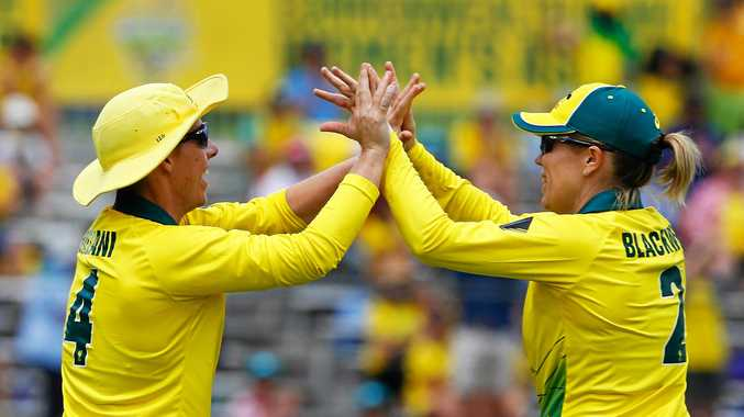 Experienced Southern Stars pair Elyse Villani and Alex Blackwell celebrates the former's catch on the boundary during the Women's Ashes One Day International in Brisbane.