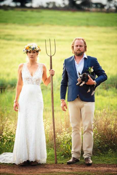 Jade and Vaughn Schultz (posing in an American Gothic parody photo) run Schultz Family Farms.