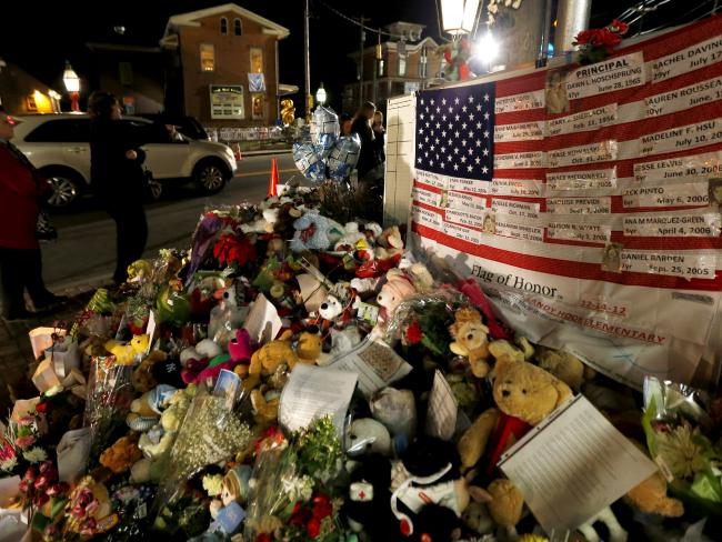 A US flag displays the name of 26 victims killed when Adam Lanza opened fired at Sandy Hook Elementary School. Picture: AP Photo/Julio Cortez