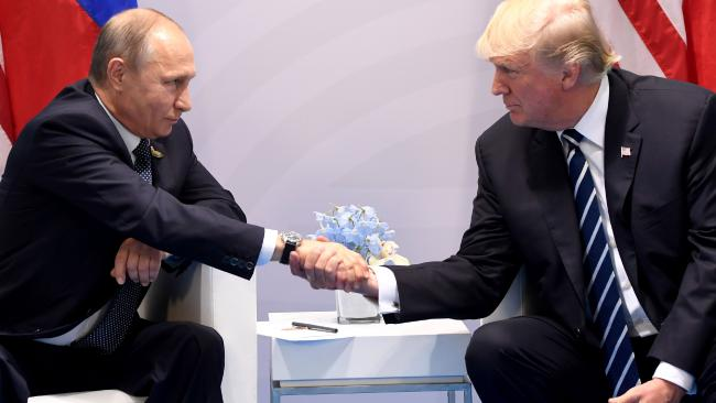 US President Donald Trump and Russian President Vladimir Putin shake hands during a meeting on the sidelines of the G20 Summit in Hamburg, Germany, last July. Picture: Saul Loeb/AFP