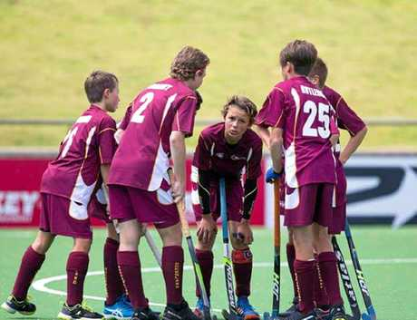 Tweed hockey player Bailey Charlesworth talks tactics with his Queensland side at the under-13 hockey nationals in Perth earlier this month.