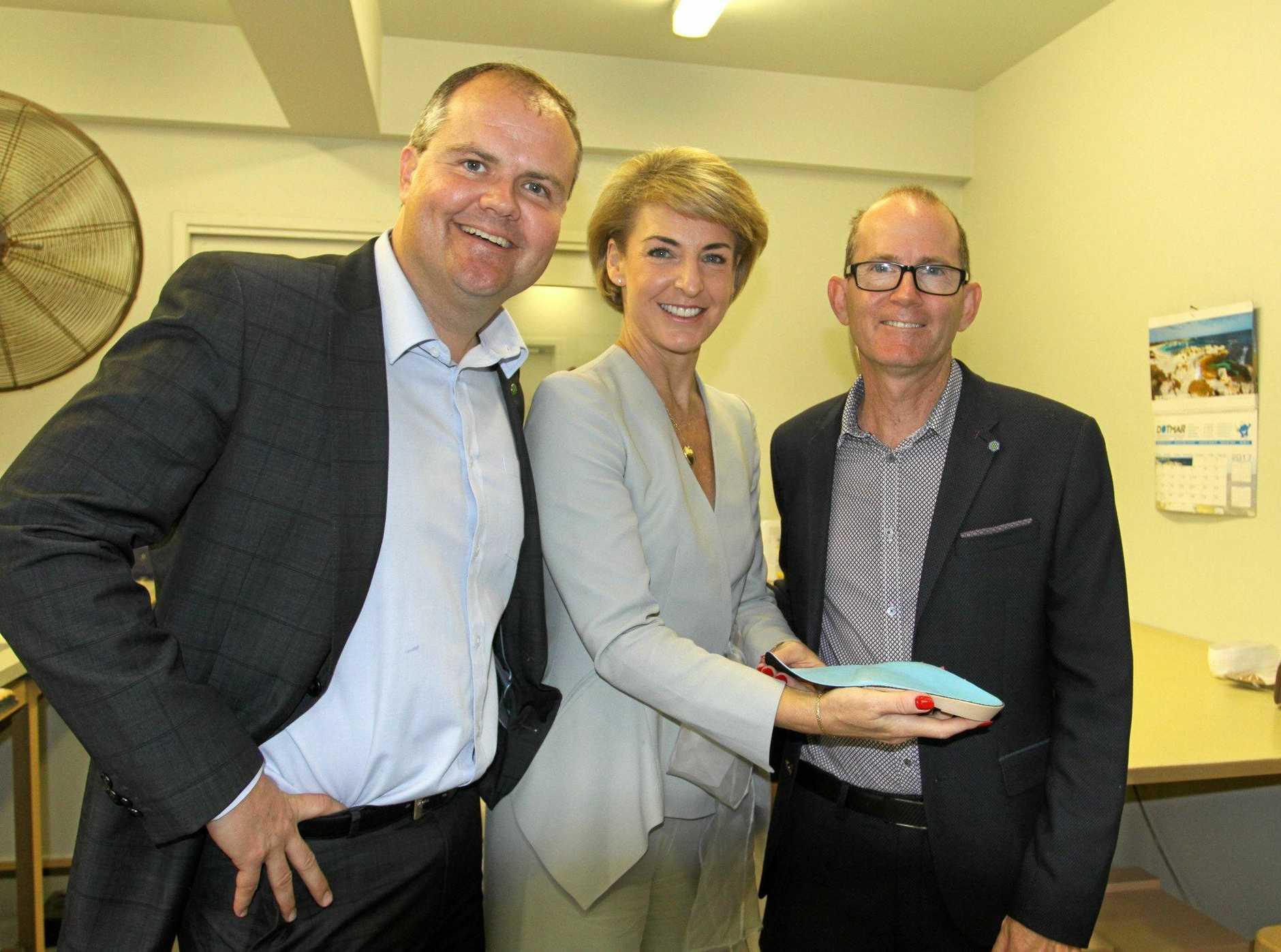 Member for Fairfax Ted O'Brien MP, Employment Minister Senator Michaelia Cash and Sunshine Coast podiatrist Dan Everson at the Marcoola factory Kinetics Orthotics.