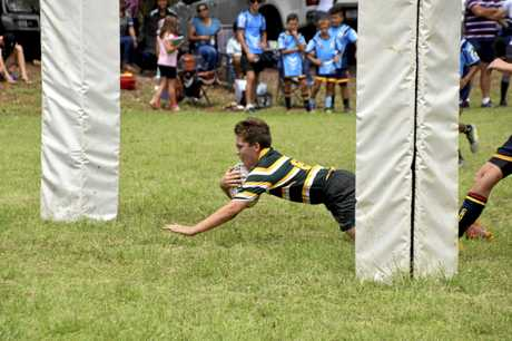 St Brendan's College under-12 player Mathew Groves goes in for a try at the Western 7s rugby union carnival in Emerald.