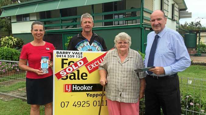 SOLD: Yeppoon's Hazel Barret celebrates the sale of her home with LJ Hooker's Gaylene Koberg, Sean Appleton and Barry Vale.