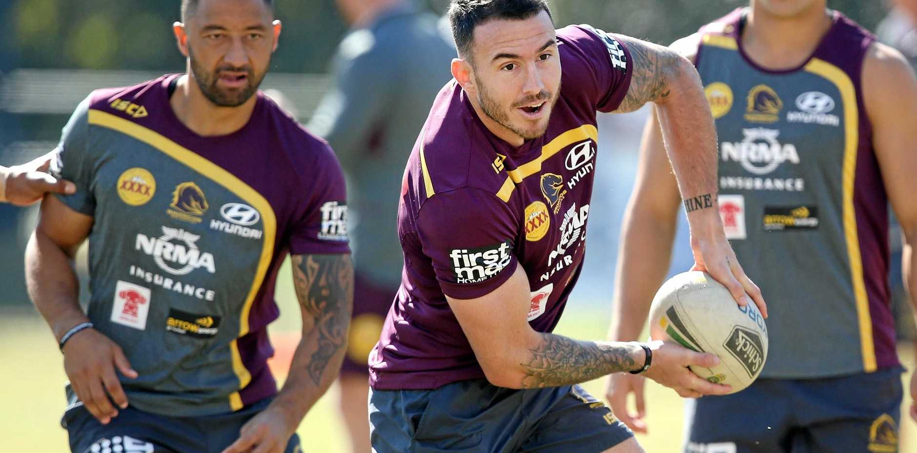 Brisbane captain Darius Boyd passes the ball during Broncos training in Red Hill