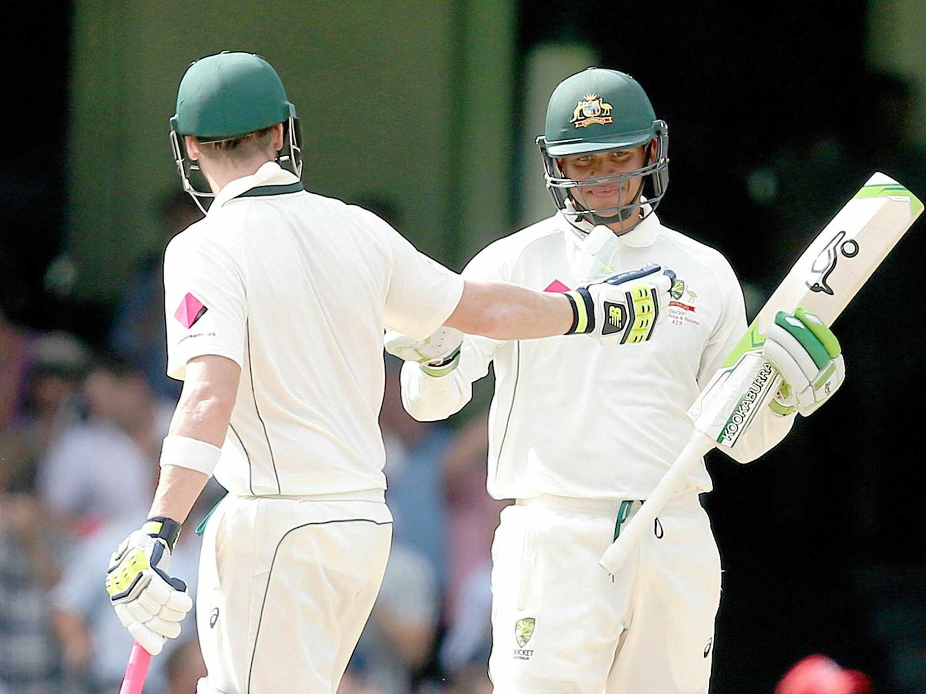Usman Khawaja of Australia (right) celebrates with captain Steve Smith after hitting his fifty runs during Day 4 of the Third Test match between Australia and Pakistan at the Sydney Cricket Ground in Sydney on Friday, Jan. 6, 2017. (AAP Image/David Moir) NO ARCHIVING, EDITORIAL USE ONLY, IMAGES TO BE USED FOR NEWS REPORTING PURPOSES ONLY, NO COMMERCIAL USE WHATSOEVER, NO USE IN BOOKS WITHOUT PRIOR WRITTEN CONSENT FROM AAP