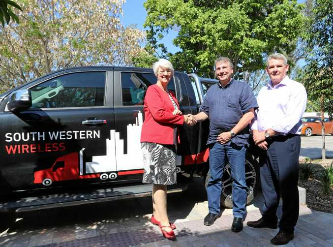 Mayor Strelow and Council's General Manager of Advance Rockhampton, Tony Cullen, meet with CEO of South Western Wireless, Geoff Peach, at their new Quay Street address.