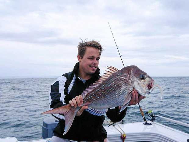 GOOD CATCH: Angler Jarrod Slatter with a 65cm snapper taken on a soft plastic on the Outer Gneerings last weekend, they also caught kingfish and long-nose trevally.