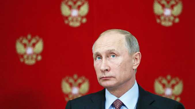 Russian President Vladimir Putin attends a media conference on Wednesday.