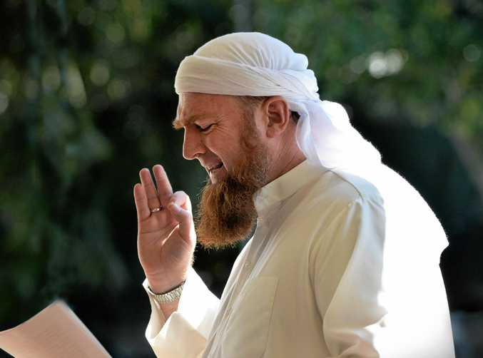 Sheik Zainadine Johnson leads prayers during his time as an Islamic community leader on the Sunshine Coast.