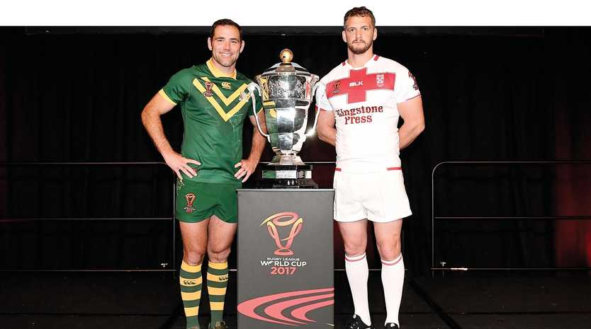 Cameron Smith of Australia and Sean O'Loughlin of England with the trophy.