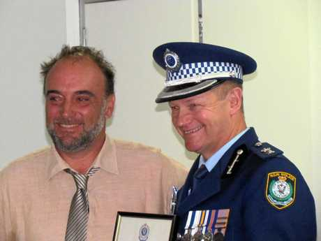 Tweed Byron LAC Superintendent Wayne Starling congratulates Ned Pannell, who received an LAC Commendation for exceptional gallantry on May 5, 2016, when he put himself at risk to help subdue a violent offender at Brunswick Heads, after the offender had just knocked a police officer unconscious, without warning.