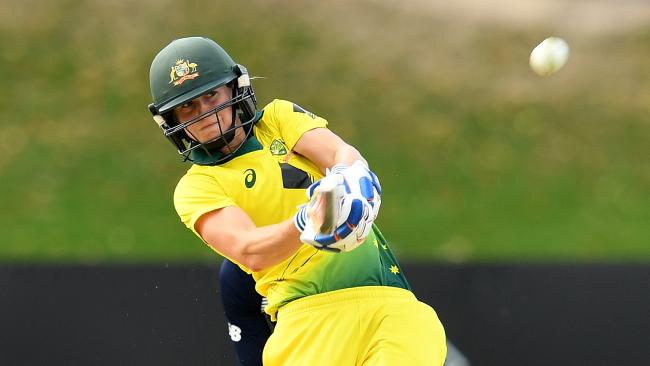 Ellyse Perry launches a huge six.