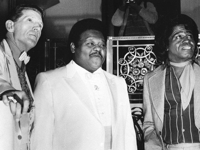 Musicians Jerry Lee Lewis, Fats Domino and James Brown pose at a reception in 1986 where they were inducted into the Rock and Roll Hall of Fame at the Waldorf-Astoria Hotel in New York. Picture: AP