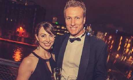 Elite bank executive Hans Borgelt and wife Julianne in happier times before they split and she accused him making her read pornography for daily sex.