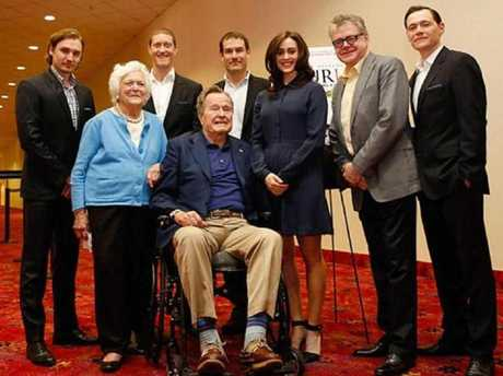 Heather Lind, pictured with her Washington's Spies castmates, and George HW Bush and his wife Barbara. Picture: Supplied