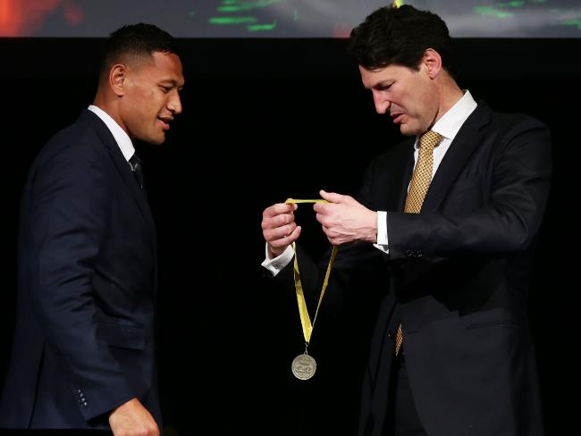 Wallabies great John Eales presents Israel Folau with the John Eales Medal in Sydney on Thursday night.