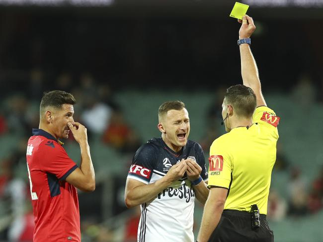 Melbourne Victory's Besart Berisha cops a yellow card against Adelaide.