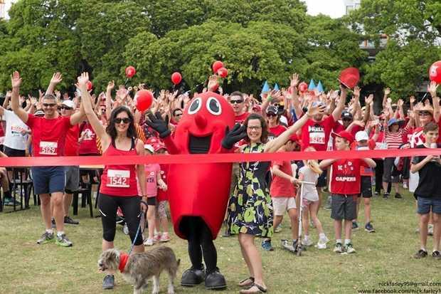 TEAM EFFORT: Morgan Woolston with her dog, Donut, at the Big Red Kidney Walk in Brisbane last month.