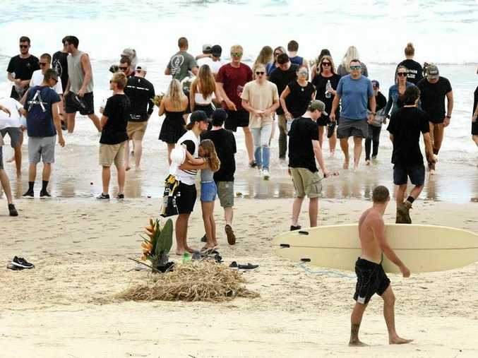 TRAGIC DAY: Family and friends gathered at Fingal Head on Monday to mourn the tragic drowning of local bodyboarder Dylan Carpenter, 20.