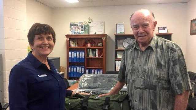 Lorraine Wirth and John Langford from Anglicare with the new bed packs for the homeless.