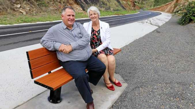 Councillor Neil Fisher and Mayor Margaret Strelow at one of the new bench seat rest stops on Pilbeam Drv.