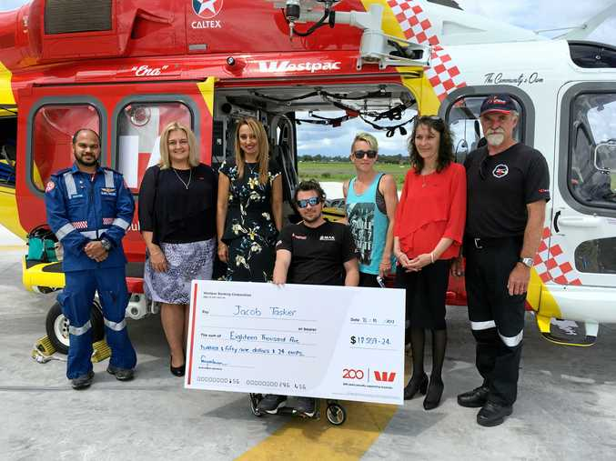 COMMUNITY SUPPORT: Jake Tasker and his family with members of the Westpac Life Saver Rescue Helicopter and Westpac bank, who presented Jake with their fundraising support.