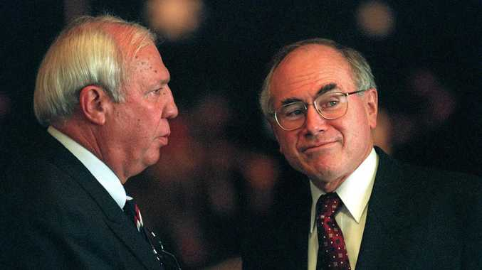 Former National director Mike Evans with then-Prime Minister John Howard in 1997.