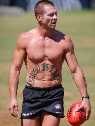 A ripped Ben Cousins shows off his stomach tattoo.