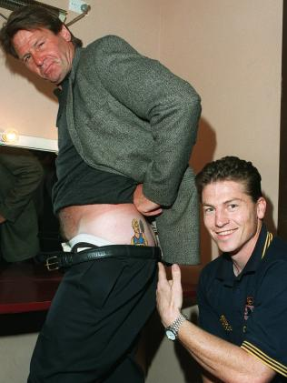 Former Adelaide captain Mark Bickley gets up close and personal with the tattoo of former teammate Tony Modra on Sam Newman's butt. Picture: Dean Martin