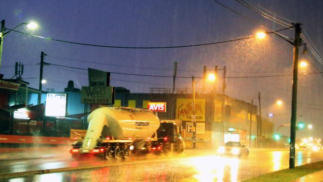 Heavy rain caused flash flooding along Parramatta Rd at Five Dock. Picture: Glenn Miller.