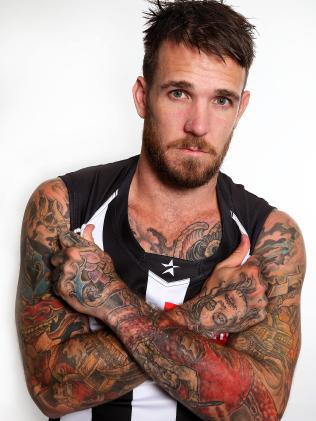 Swanny always loves to show off his ink. Picture: Wayne Ludbey