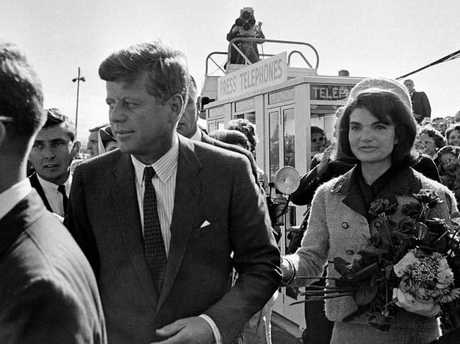 John and Jackie Kennedy, arrive at Love Field airport on the morning of the assassination.