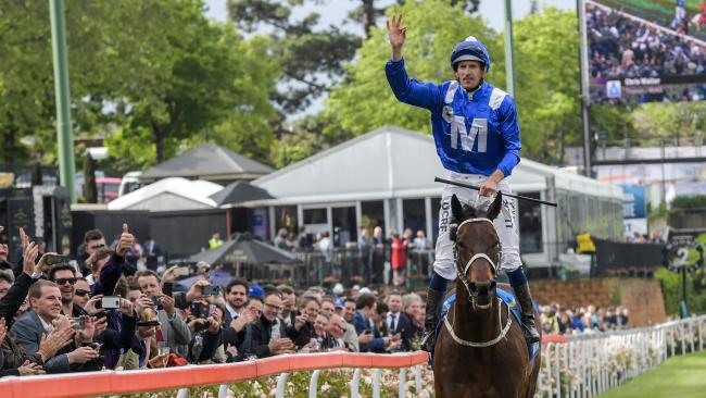 Hugh Bowman salutes the crowd after Winx blitzed her rivals in last year's Cox Plate. Picture: Mike Keating/Racing Photos