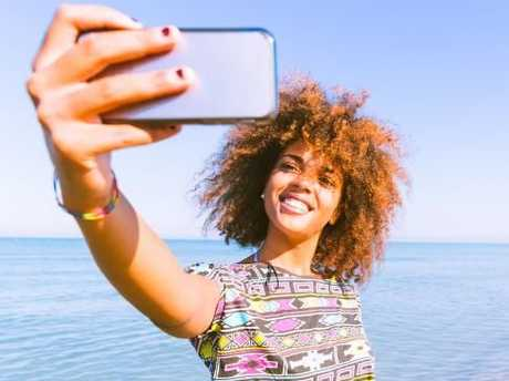 Research revealed that more people died from taking selfies than from shark attacks in 2015. Picture: iStock