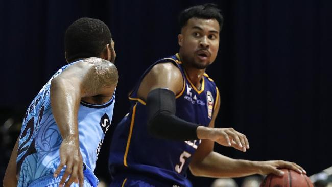 Stephen Holt of the Brisbane Bullets tries to dribble past DJ Newbill of the New Zealand Breakers during the NBL round 4 game played at the Brisbane Convention and Exhibition Centre, Brisbane, Thursday, October 26, 2017. (AAP Image/Regi Varghese) NO ARCHIVING, EDITORIAL USE ONLY
