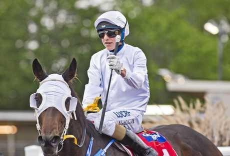 Apprentice Baylee Nothdurft returns to the Clifford Park winner's stall last night on One Golden Day.
