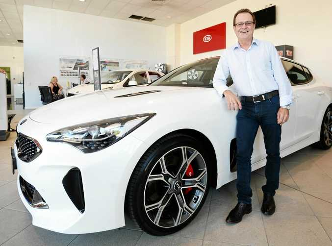 BIG SWITCH: Jamie Burk with his new Kia Stinger, which he picked up yesterday.